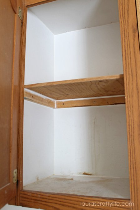 Laundry room cabinet renovation laura 39 s crafty life for Caulking around kitchen cabinets